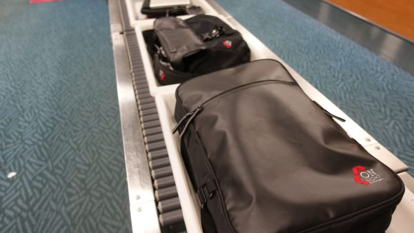 bags on baggage rack at airport